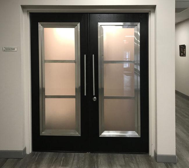 Custom door with stainless steel trim